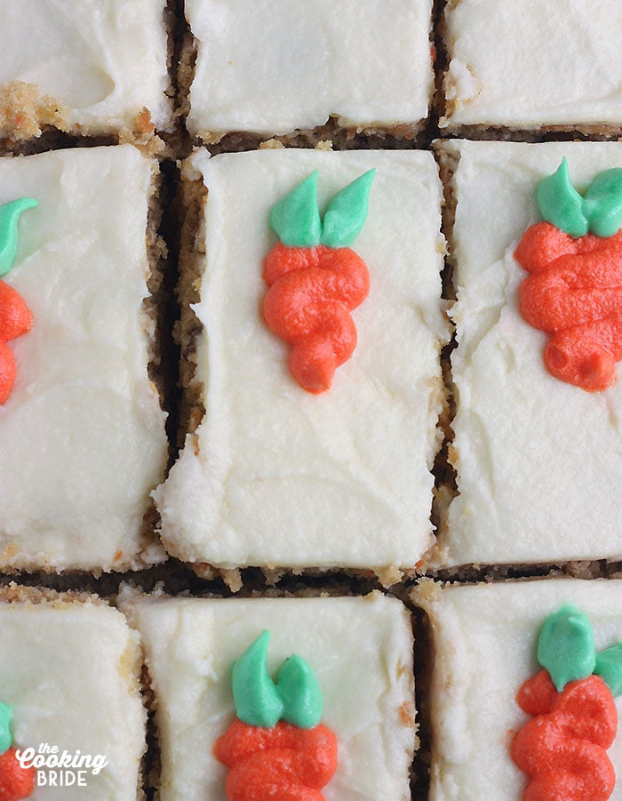 sliced carrot cake decorated with icing carrots