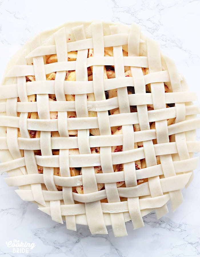 unbaked pie topped with a finished lattice crust