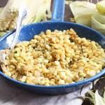 fried corn in a blue skillet