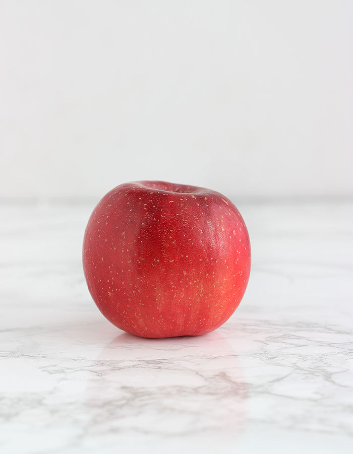red fuji apple on a white background