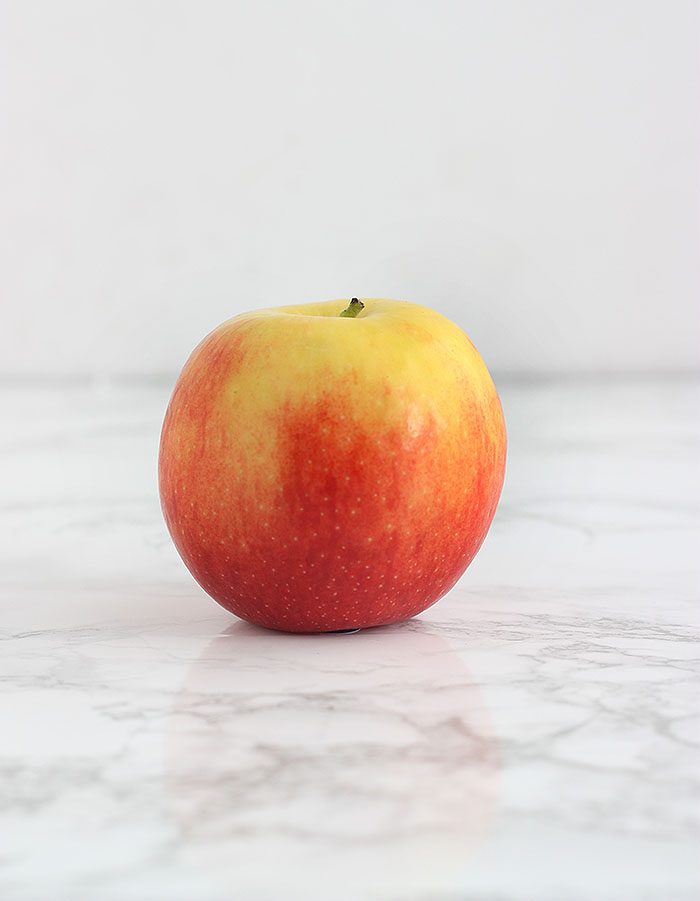 yellow and pink jazz apple on a white background