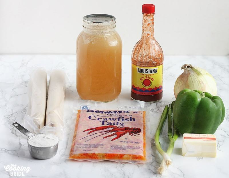 crawfish pie ingredients inclduing flour, pie crusts, stock, hot suace, green onion, butter, green bell pepper and onion