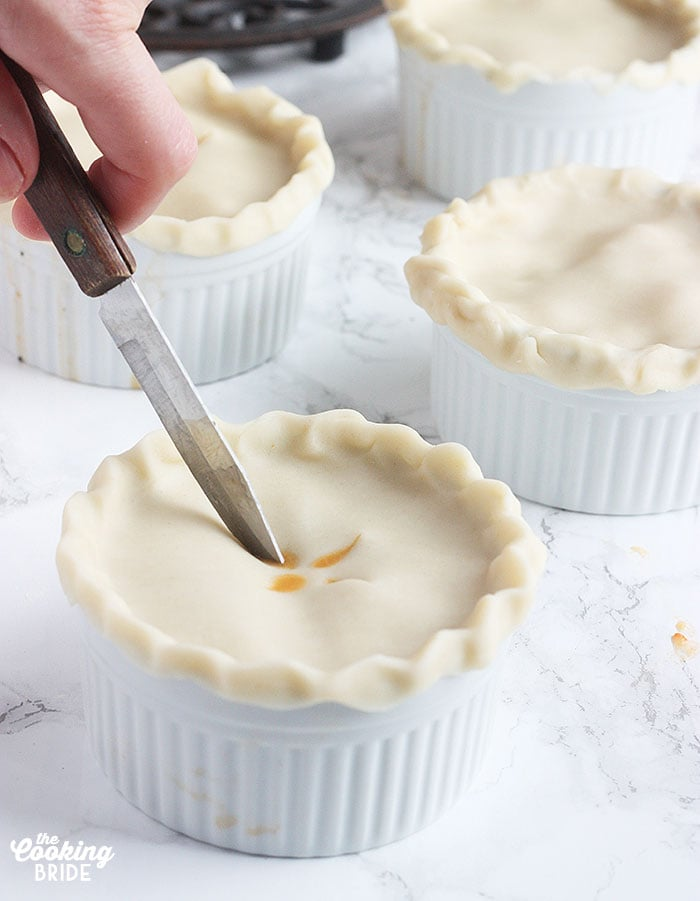 cutting slits into the top of an unbaked pie shell