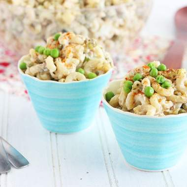 creamy tuna macaroni salad in small blue serving bowls