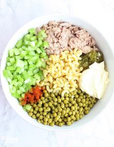 salad ingredients before they are mixed in a large mixing bowl