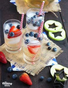 three glasses of berry punch with star apple cut outs and fresh berries on the side