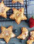 Star shaped fried pies cooling on a baking rack