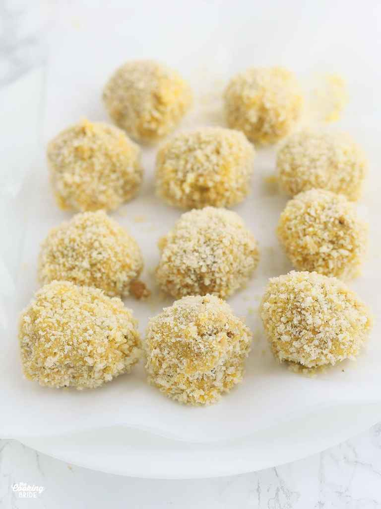 boudin balls coated in Panko breadcrumbs waiting to be fried