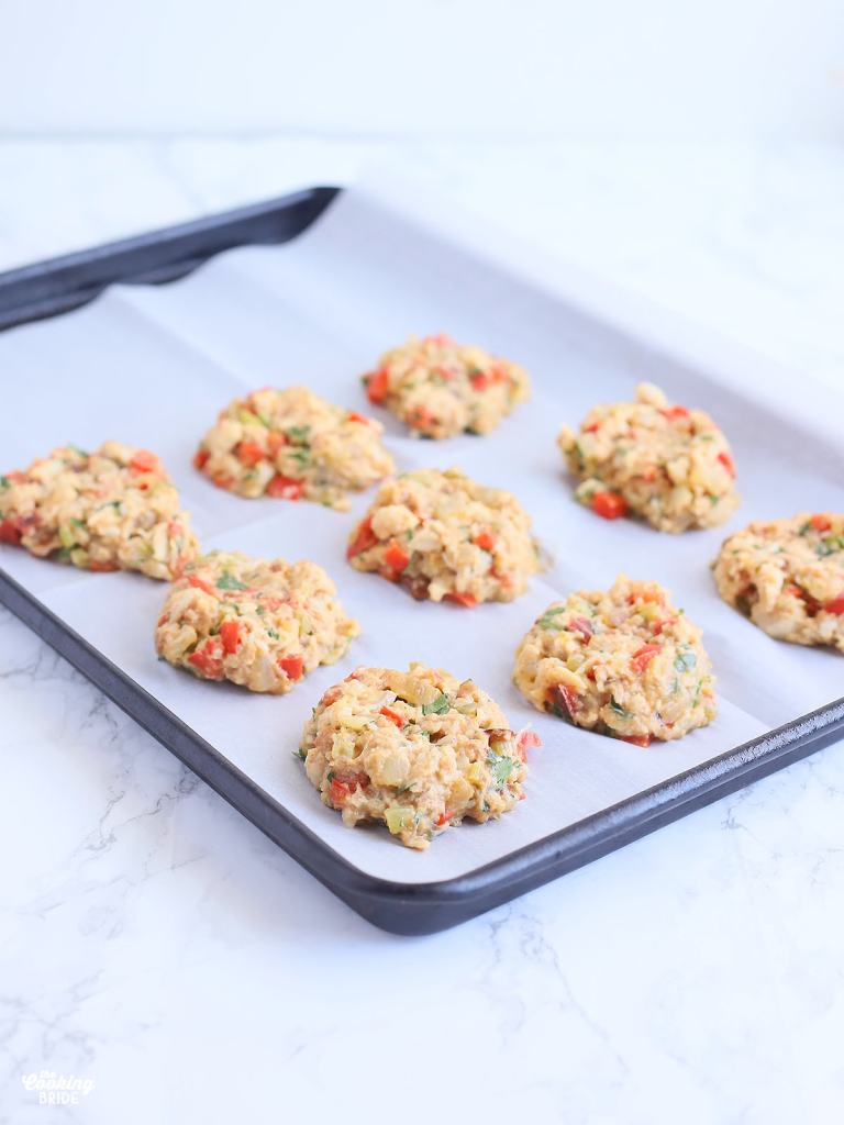 unbaked crab cakes on a baking sheet
