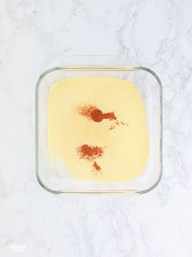 cornmeal and paprika in a glass dish