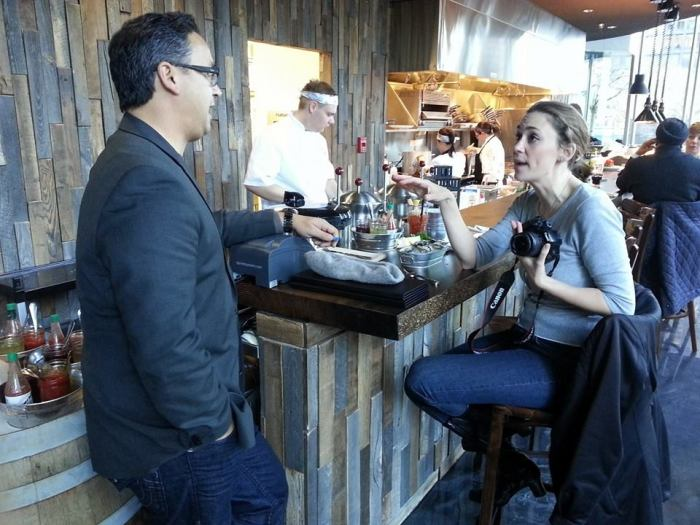 Interviewing Richard Chew, restaurant owner. Photo by Charles Zuckermann