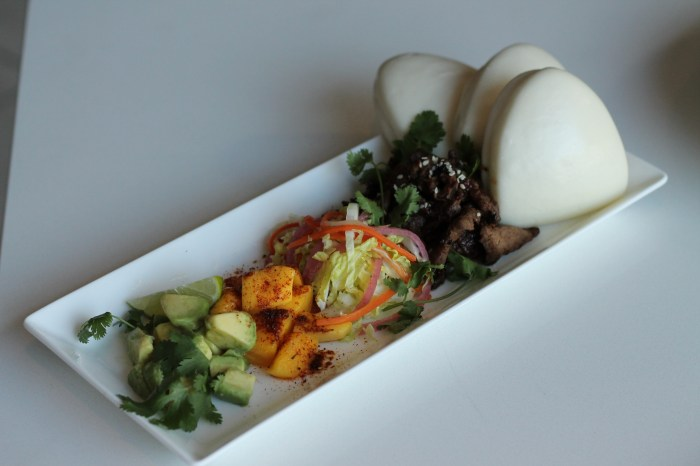 """Simon says """"this is a dish we're really proud of."""" This play on tacos is called Nam Prik """"Cow"""": seared beef tenderloin with chili mango, lime avocado, and sesame su choy, served with asian steam buns."""