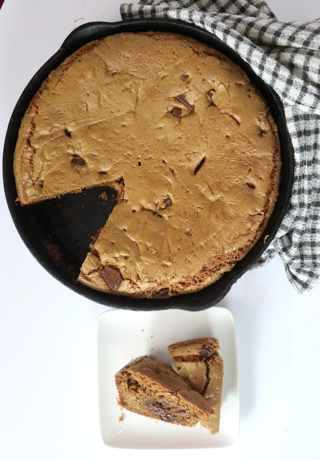 Flourist Chocolate Chip Cookie baked in a large cast iron sklllet