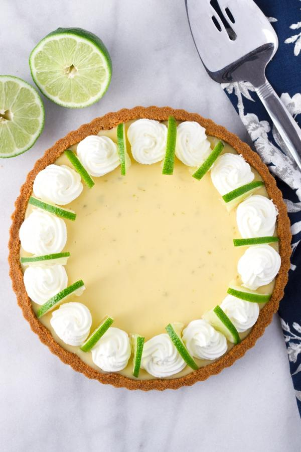 Key Lime Tart with Lime Slices and Whipped Cream