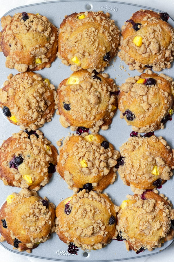 Blueberry and Peach Muffins in a Muffin Tin
