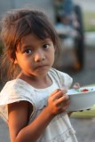 Young girl in Phnom Pen, Cambodia eating pho