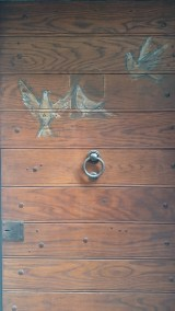 Doves on wooden door