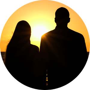 Silhouettes of couple behind Cooking Journey Blog. Looking at the sunset on the seaside