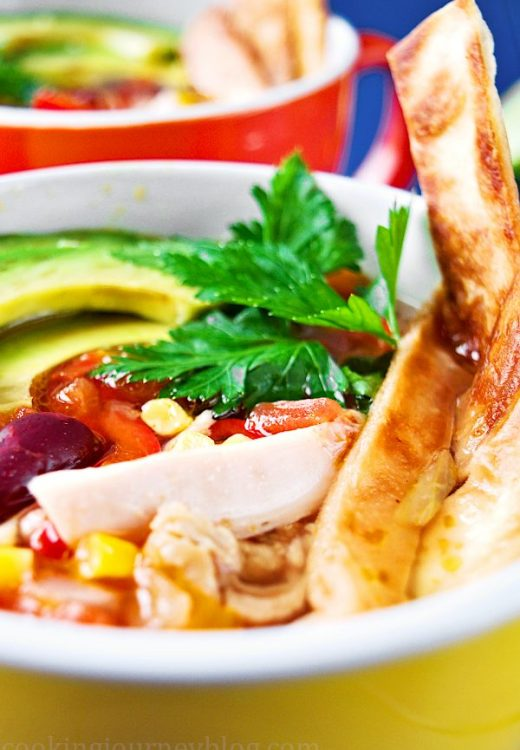 Mexican tortilla soup is easy, spicy and colorful comfy food you need to make this season! This delicious and really hot Mexican chicken soup with crunchy tortilla and creamy avocado on top will warm you and fill you up.