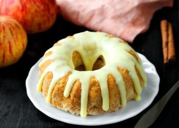 Apple bundt cake with white chocolate on top. Are you searching for apple coffee cake? This apple bundt cake is perfect for pairing with your morning coffee or tea. Mini bundt cake recipe for one.