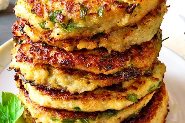 Cauliflower fritters with parsley, served on the gray table with tea. Cauliflower fritters – best cauliflower recipe for healthy breakfast. You need no milk, no sugar to make this easy pancake recipe tasty! This is one of breakfast ideas for kids, that you should try.