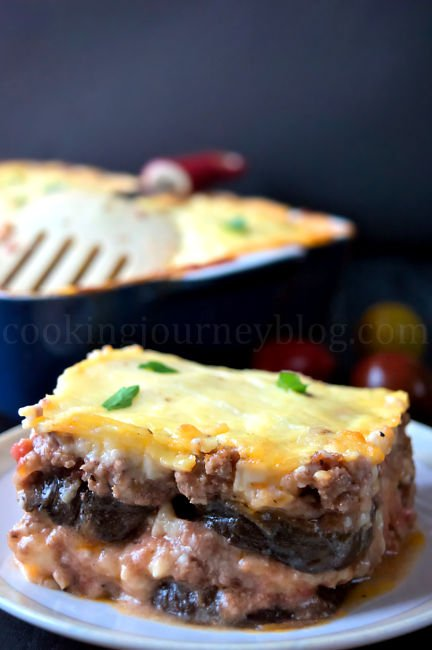 Slice of moussaka with eggplant, beef and cheese on top.