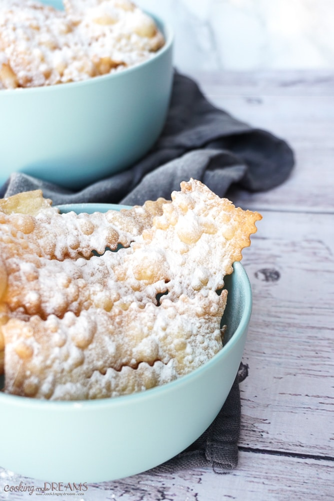 Close up view of a bowl of fried pastries