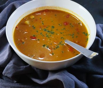 Overhead bowl of vegetable soup with garam masala spices