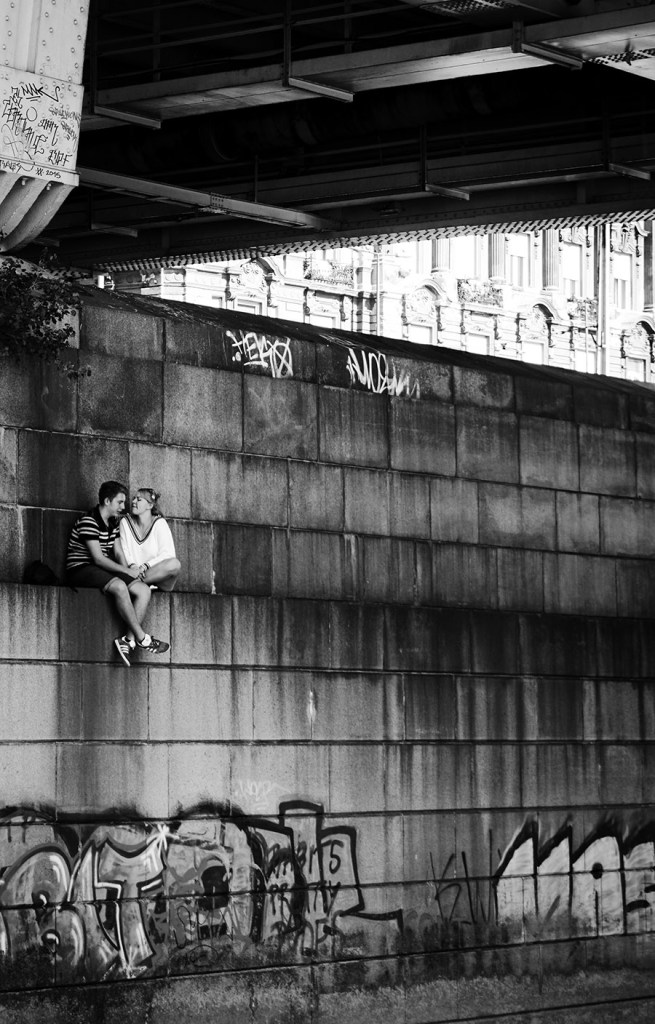 couple hiding under a bridge in Budapest, black and white