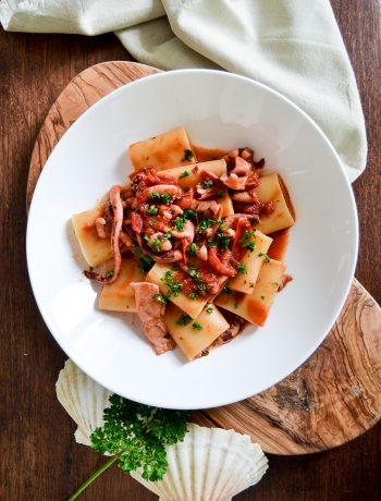 calamarata pasta with squids and tomato sauce