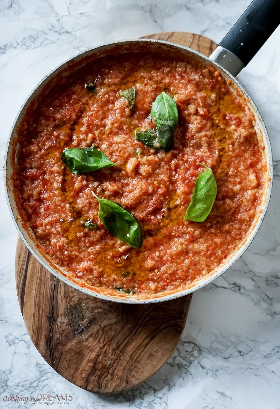 pan of italian bread and tomato dish pappa al pomodoro with basil