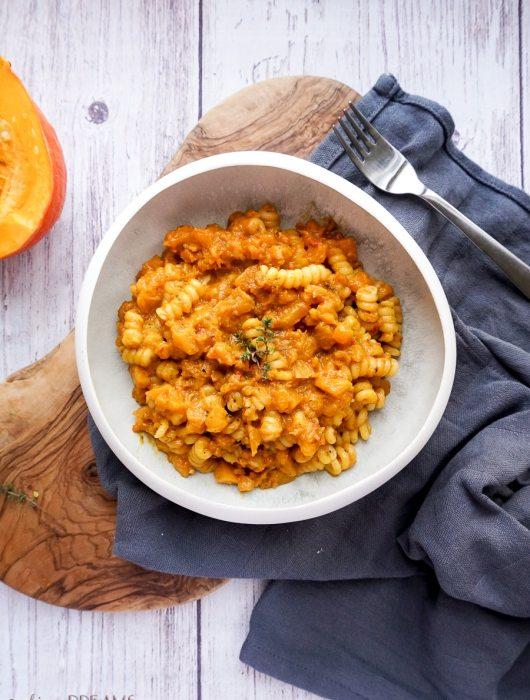 white bowl with pumpkin 'nduja pasta