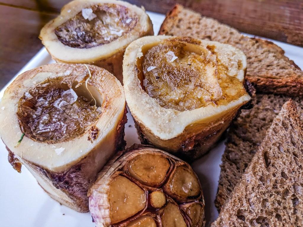 Roast Bone Marrow with Roasted Garlic and Rye Toasts