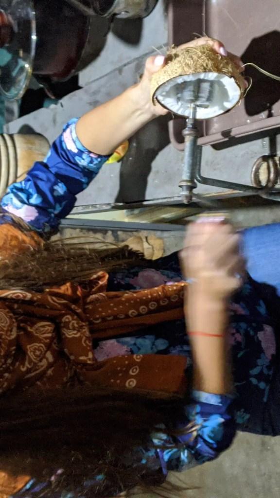 Alona grating the coconut to make coconut milk