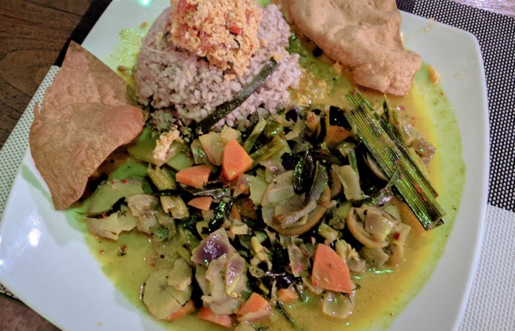 Sri Lankan style mixed vegetable curry with red rice, poppadum crackers, and coconut sambal