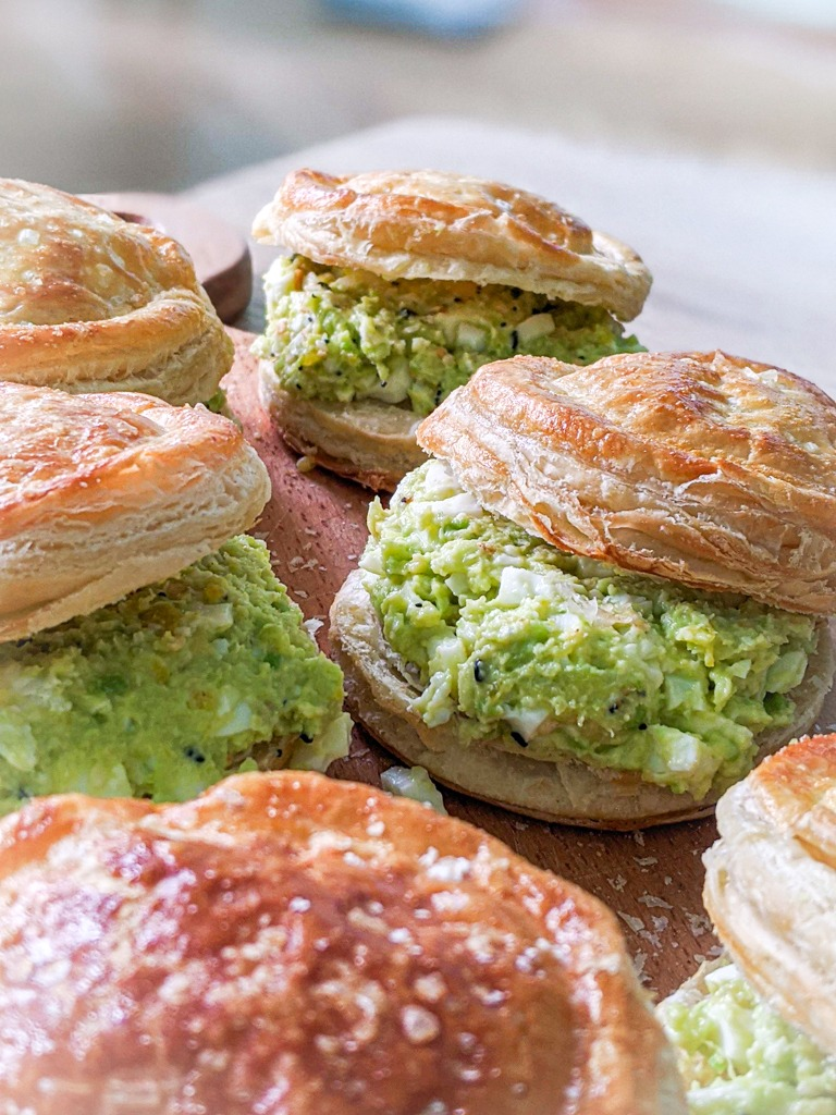 avocado egg salad sandwich on puff pastry biscuits