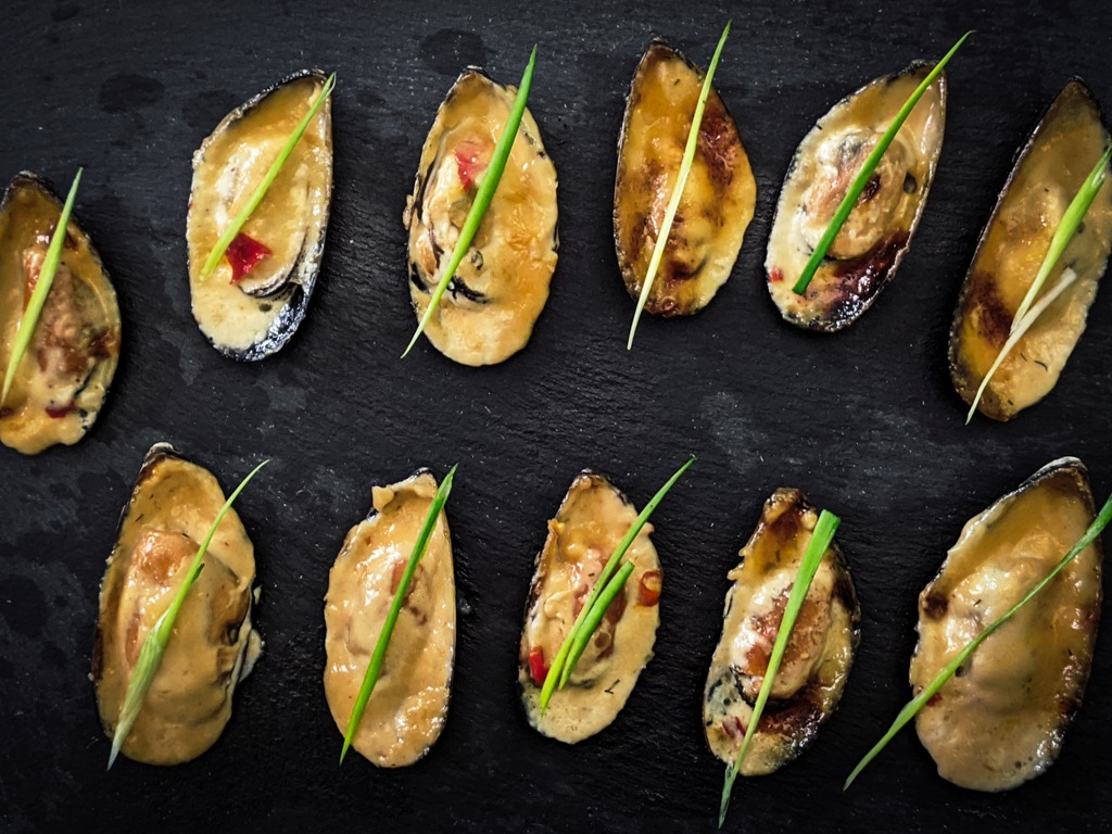 Asian Baked mussels with a green onion sliver garnish