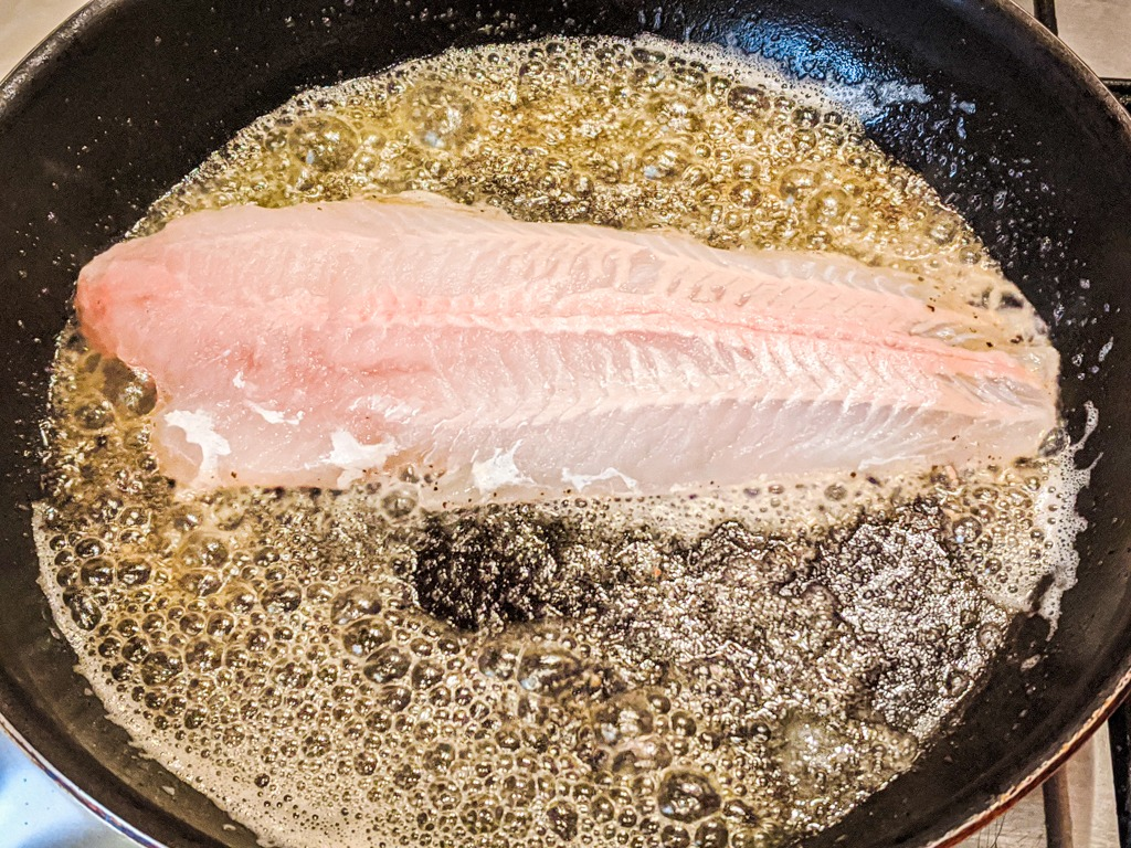 searing the hake in butter