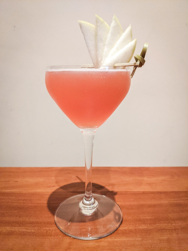 jack rose cocktail with an apple fan garnish
