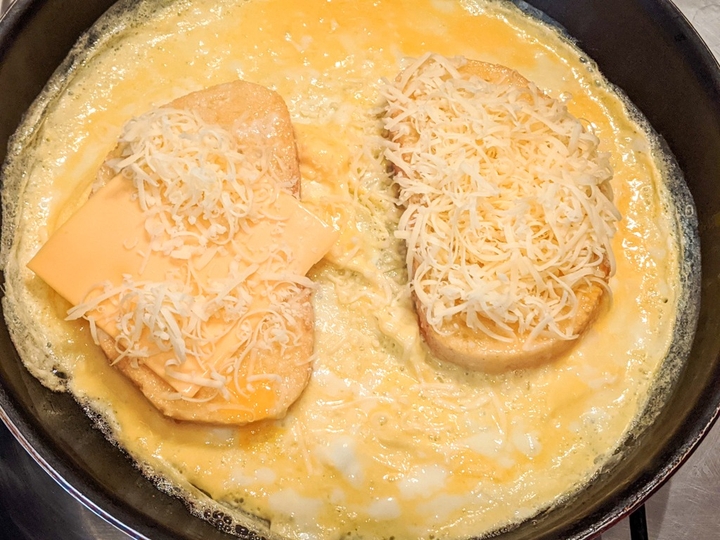 Making the indian bread omelet in the pan