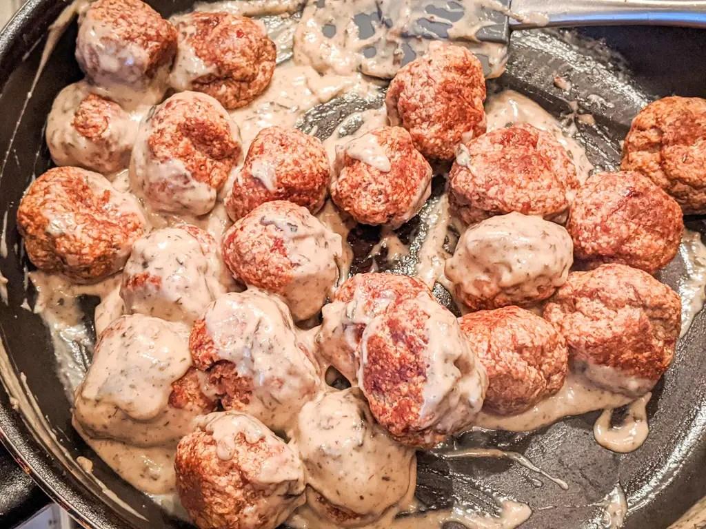 Pork Meatballs In Morel Sauce being tossed in the pan
