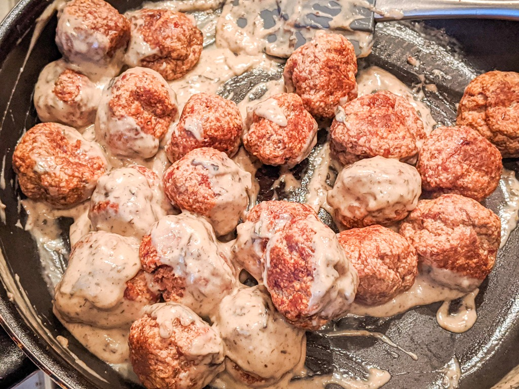 Pork Meatballs In Morel Sauce being tossed in the pan