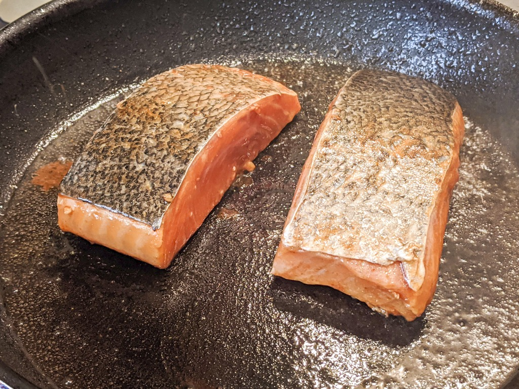 searing the salmon fillets