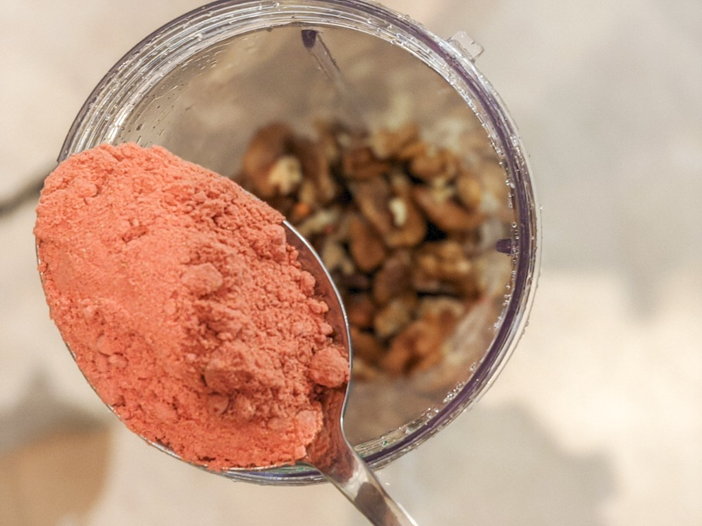 I use my nutribullet to combine the dehydrated strawberry powder with the walnuts