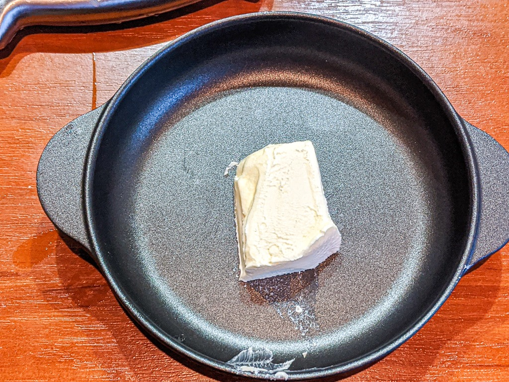 butter in a cast iron pan