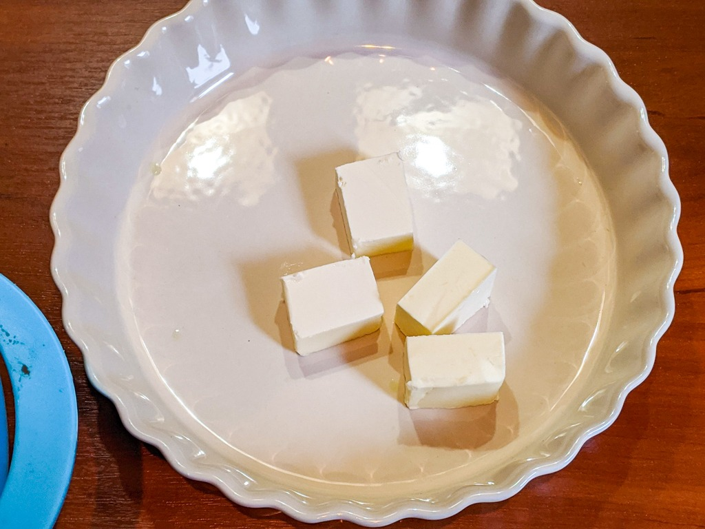 cold butter on the bottom of a baking tart tray