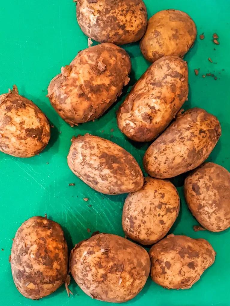 yellow potatoes ready to be peeled