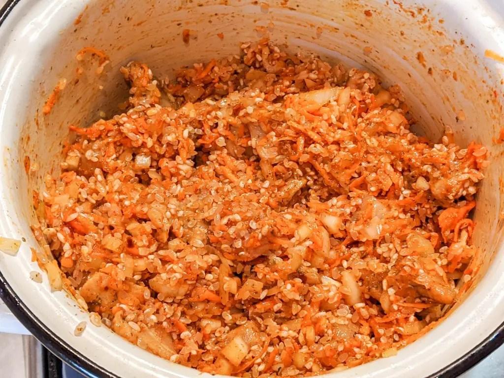 Ukrainian Pork Plov (Rice Pilaf) in a pot before liquid