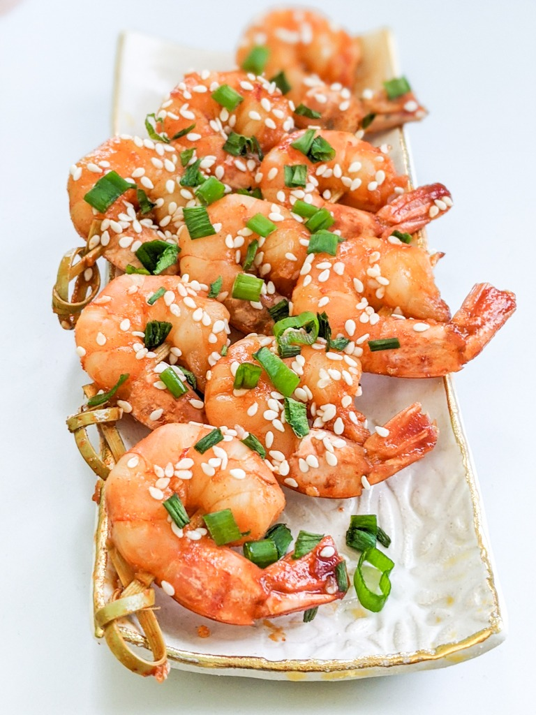 Korean Gochujang Prawn Skewers with white sesame seeds and chopped green onions