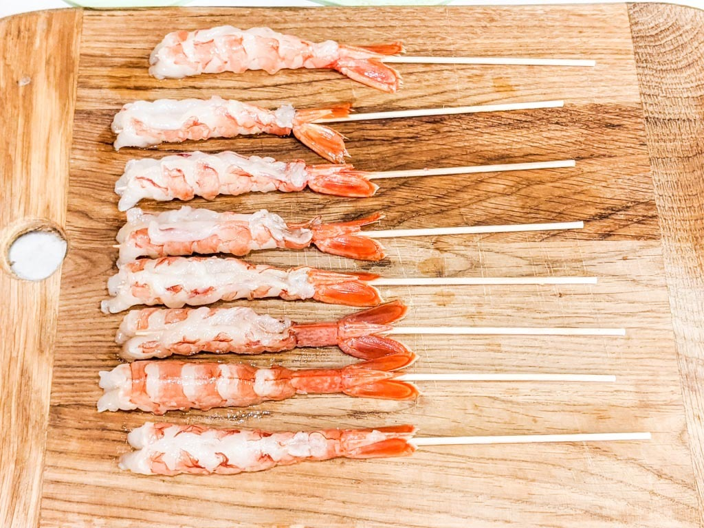 red shrimp with skewers